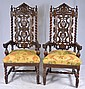 Pair of carved oak throne chairs with dog heads