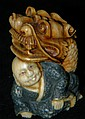 Signed Oriental decorated figural netsuke