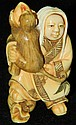 Signed ivory carved netsuke with two sided face