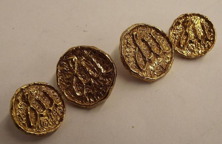 Four Sterling Silver Goldwash Buttons