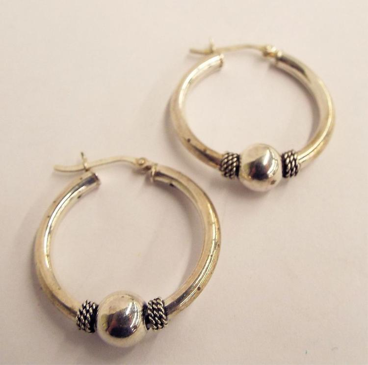 Pair Of Sterling Silver Hoop Earrings