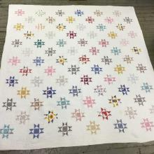 Hand Sewn Multi Colored Quilt With Star Pattern