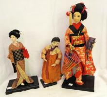 Group Of 3 Oriental Fabric Dolls On Stands