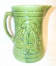 Green Stoneware Pitcher With Figural Scene