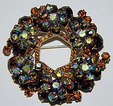 Amber and blue rhinestone pin