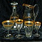 Set of glassware with gilt trim, pitcher, decanter