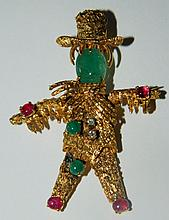 14 kt. gold, ruby, diamond and emerald brooch