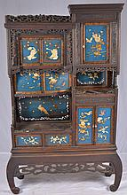 Oriental etagere cabinet with applique scenes