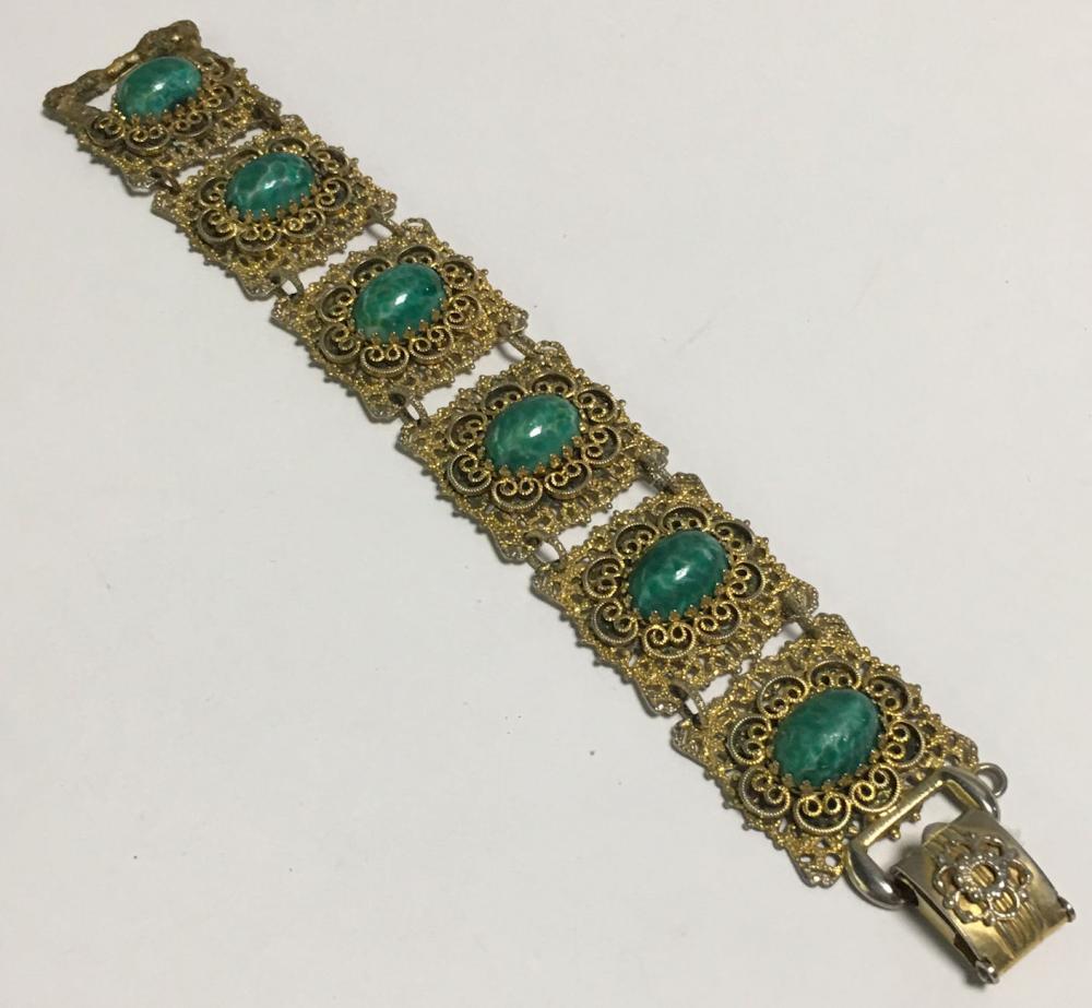 Goldtone Filigree Bracelet With Green Stones