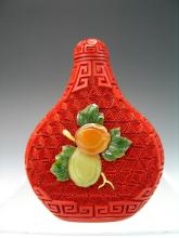 Chinese carved lacquer snuff bottle.