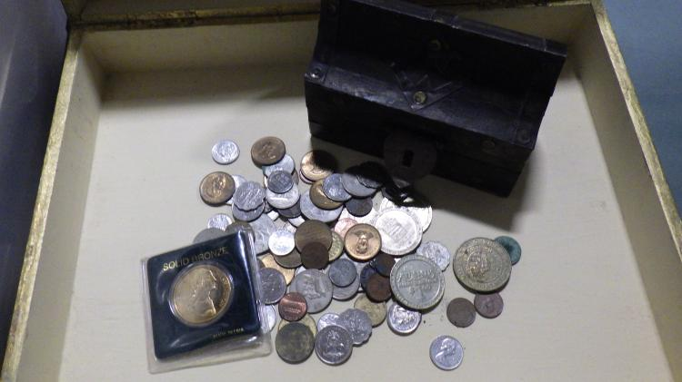 Box With Foreign Currency and Tokens