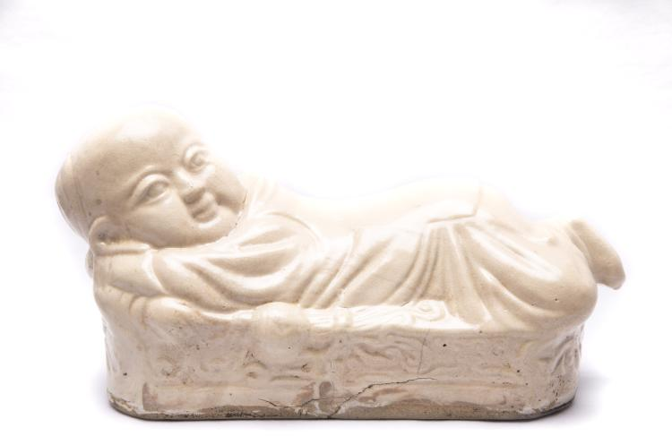 A Chinese Carved Porcelain Pillow