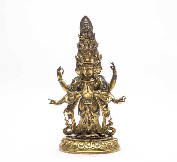 A Chinese Gilt Bronze Figure of GuanYin with Eleven Faces