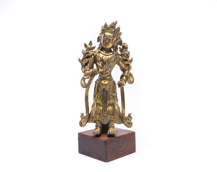 A Chinese Gilt Bronze Standing Buddha