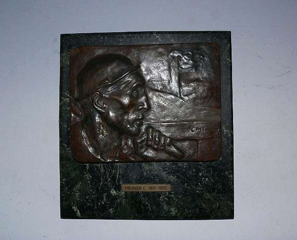 Constantin Emile Meunier (Belgian, 1831-1905): A bronze portrait plaque of the head of a miner