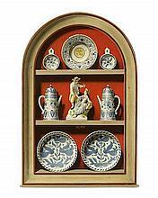 Clifford Harrison (British, 1901-1984) An alcove of Delftware