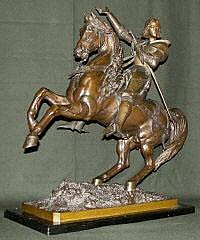 A bronze statuette of Joan of Arc by Leveel: