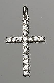 A GOLD AND DIAMOND PENDANT CROSS