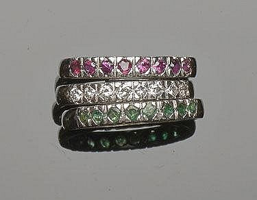 A SET OF GOLD, EMERALD, RUBY AND DIAMOND RINGS