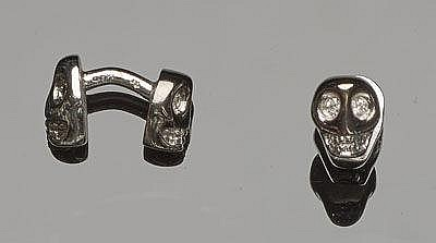 A PAIR OF SILVER AND DIAMOND CUFFLINKS