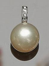 A GOLD, PEARL AND DIAMOND PENDANT