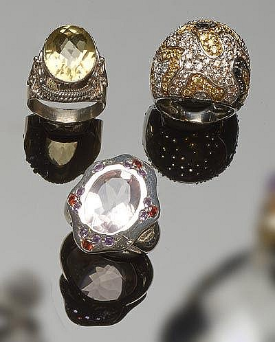 A SET OF THREE STERLING SILVER, QUARTZ AND ZIRCON RINGS