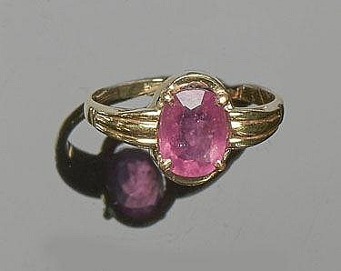A GOLD AND RUBY RING