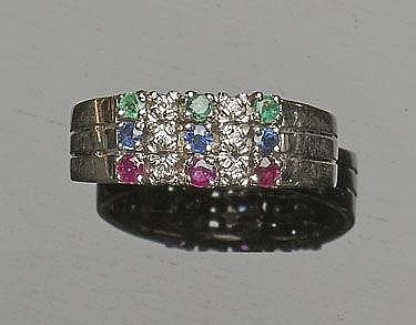 A GOLD, SAPPHIRE, RUBY, DIAMOND AND EMERALD RING