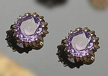 A PAIR OF VINTAGE GOLD AND AMETHYST EARRINGS