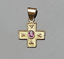 A GOLD AND RUBY CROSS PENDANT