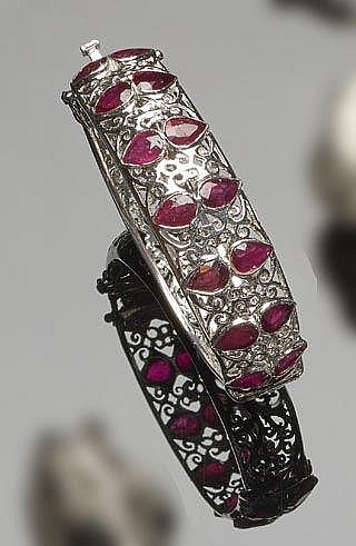A SILVER AND RUBY BANGLE BRACELET
