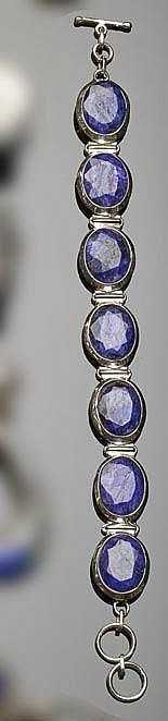 A STERLING SILVER AND SAPPHIRE BRACELET