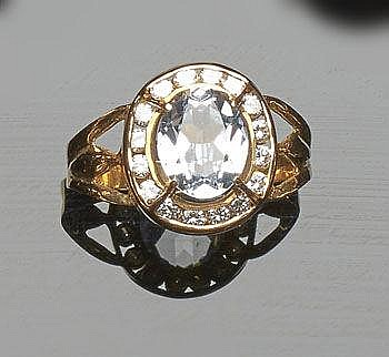 A GOLD, ZIRCON AND BLUE GEMSTONE RING