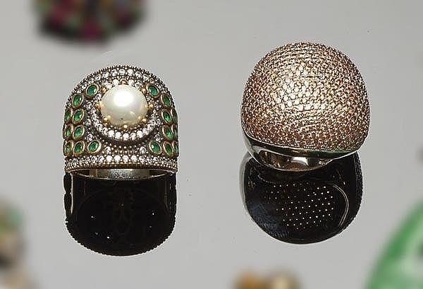 A STERLING SILVER AND ZIRCON RING; A SILVER, BRONZE, ZIRCON, GREEN GEMSTONE AND PEARL RING AND