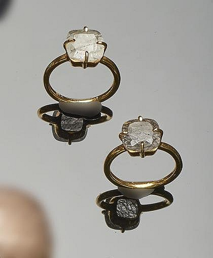 A PAIR OF GILT SILVER AND QUARTZ RINGS