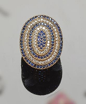 A SILVER, BRONZE, BLUE GEMSTONE AND ZIRCON RING