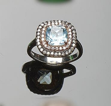 A STERLING SILVER, BLUE GEMSTONE AND ZIRCON RING