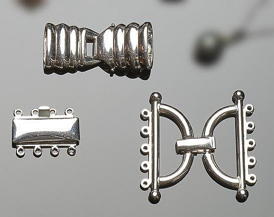 A SET OF STERLING SILVER NECKLACE CONNECTORS