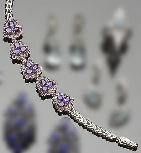 A STERLING SILVER, AMETHYST AND RUBY BRACELET