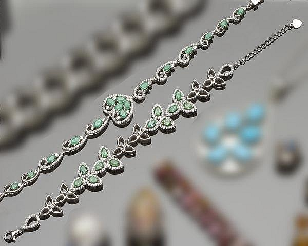 A PAIR OF STERLING SILVER, EMERALD AND ZIRCON BRACELETS
