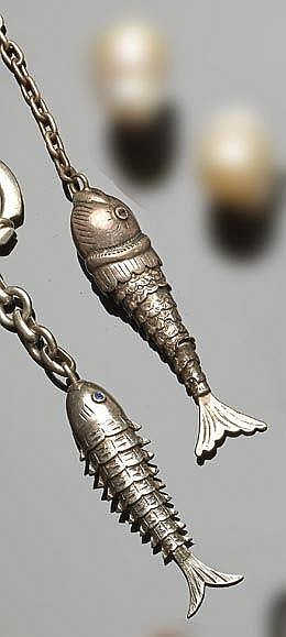 A PAIR OF VINTAGE SILVER KEY-RINGS