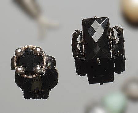 A PAIR OF STERLING SILVER AND ONYX RINGS