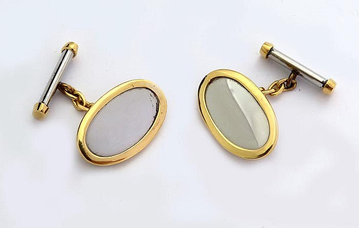 A PAIR OF STEEL AND GOLD CUFFLINKS