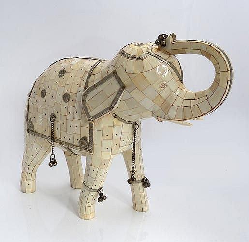 AN IVORY ELEPHANT FIGURINE