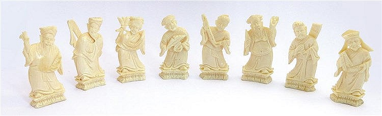 EIGHT CARVED IVORY FIGURES