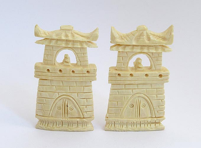 A PAIR OF CARVED IVORY TOWERS