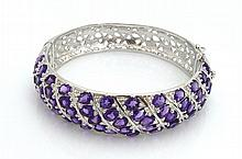 A STERLING SILVER AND AMETHYST BRACELET