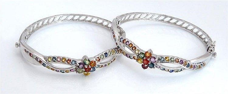 A PAIR OF STERLING SILVER AND ZIRCON BRACELETS