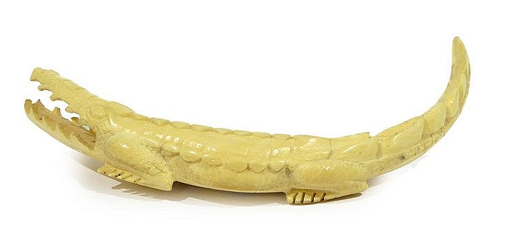 AN IVORY CROCODILE FIGURINE
