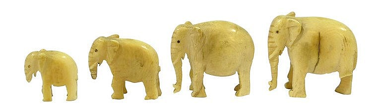 A SET OF FOUR IVORY ELEPHANT FIGURINES